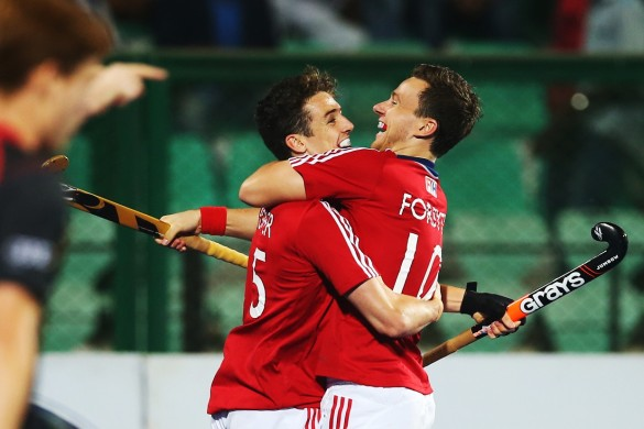 RAIPUR, INDIA - DECEMBER 01:  Phil Roper of Great Britain celebrates scoring with Alan Forsyth of Great Britainduring the match between Great Britain and Belgium on day five of The Hero Hockey League World Final at the Sardar Vallabh Bhai Patel International Hockey Stadium on December 01, 2015 in Raipur, India. (Photo by Ian MacNicol/Getty images) *** Local Caption *** Phil Roper ; Alan Forsyth